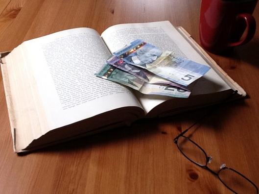 Money lying on an open book