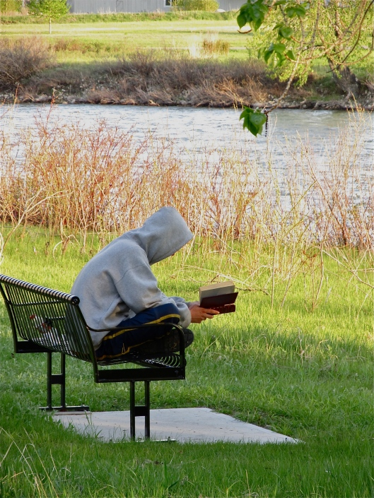 A quiet moment with book and river