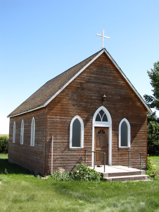 Old Wooden Church Surrounded by Fields